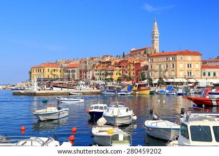 Old Venetian town harbor with small boats anchored on the Adriatic sea, Rovinj, Croatia - stock photo