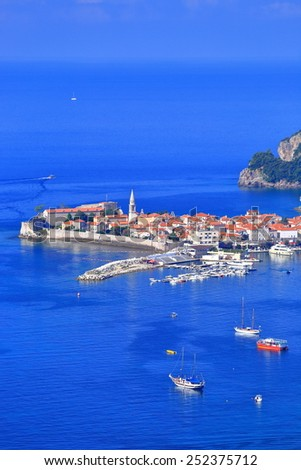 Old Venetian town surrounded by vast waters of the Adriatic sea, Budva, Montenegro - stock photo