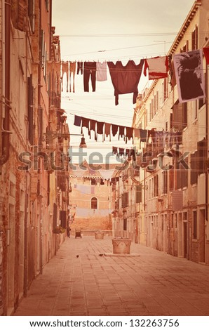 Old Venetian yard, Italy.Photo in old color image style. - stock photo