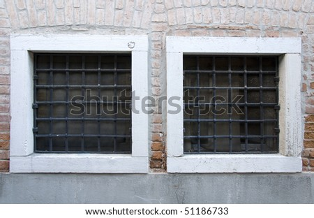Old Venice Windows with metal bars - stock photo