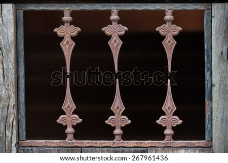 Old ventilation grille with traces of rust - stock photo
