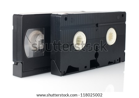 Old VHS Video tapes isolated on white background. - stock photo