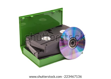 Old Video Cassettes tapes with DVD disc isolated on white background  - stock photo