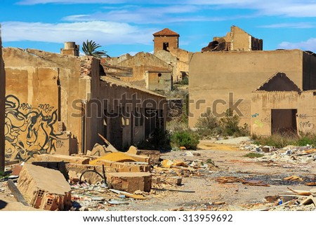 old village destroyed in ruins and abandoned by the bombs of war - stock photo