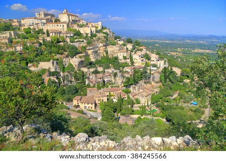 Old village of Gordes on a green hillside, Provence-Alpes-Cote d'Azur, France