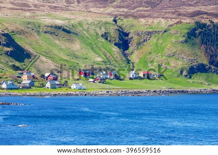 Old village on the coast of Norway - stock photo