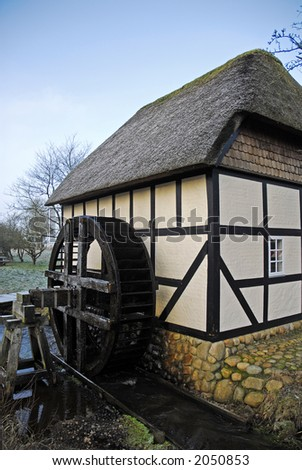 Old village water mill used to grinding grain for local farmers. Jutland, Denmark. - stock photo
