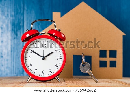 Old vintage alarm clock and door key against house shape and blue background. Time to & Old Vintage Alarm Clock Door Key Stock Photo \u0026 Image (Royalty-Free ...