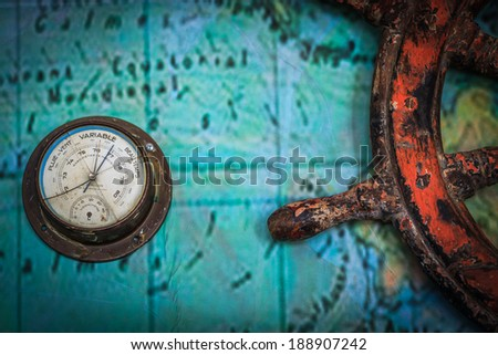 Old vintage barometer made in France attached on a wall - stock photo