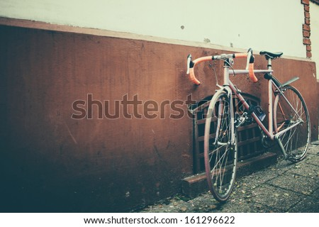 old vintage bike on the street - stock photo