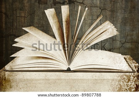 old vintage book in an old room - stock photo