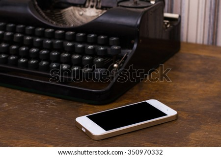 Old vintage books, smartphone on a wooden table - stock photo