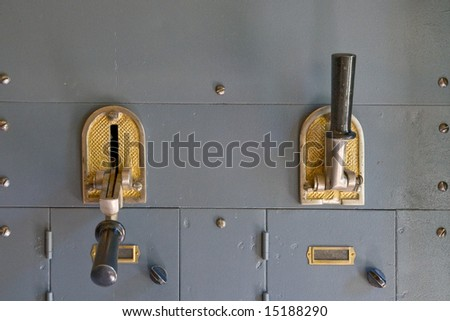 Old vintage bronze wall-mounted electric switches