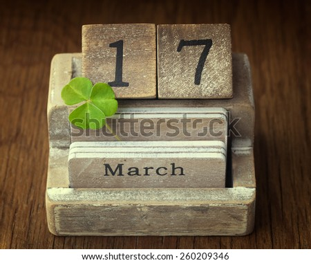 Old vintage calender showing the date 17th of march which is St.Patricks day with a lucky clover - stock photo