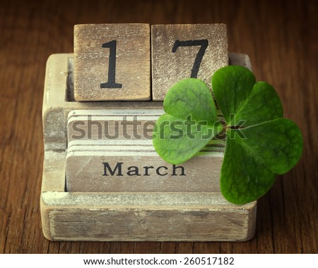 Old vintage calender showing the date 17th of march which is St.Patricks day with lucky shamrock - stock photo