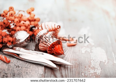 Old vintage christmas decorations on wooden background  - stock photo