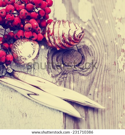 Old vintage christmas decorations on wooden background