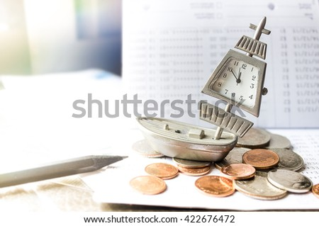 old vintage clock and coin with banking account in background,lens flare - stock photo