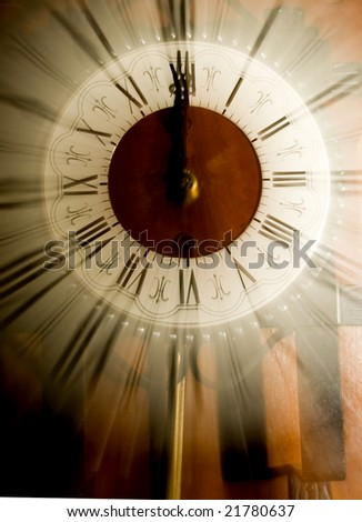 Old vintage clock blurred in - stock photo
