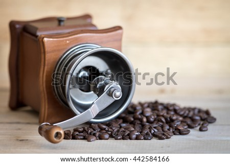 old vintage coffee grinder with coffee beans - stock photo