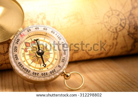 Old vintage compass with vintage map - stock photo