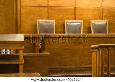 Old vintage court room. Close-up of the judges chairs. - stock photo