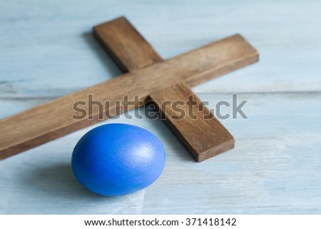 Old vintage cross and abstract blue easter egg symbol simple idea - stock photo