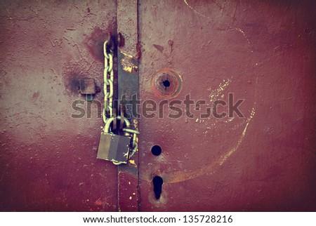 Old vintage door lock background/texture in sepia. - stock photo