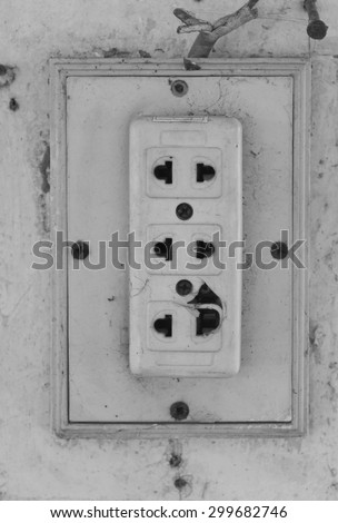 old vintage electric plug socket with wall background. - stock photo