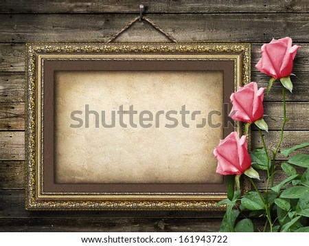 Old vintage frame for photos and a bouquet of yellow  roses - stock photo