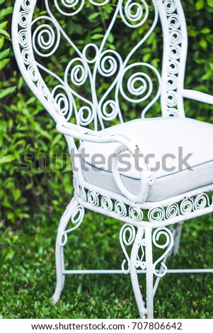Old Vintage Furniture In Garden With Natural Green Background. White Metal  Chair And Table,