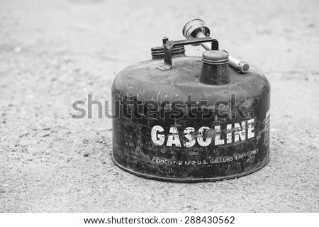 Old vintage gasoline can on concrete background (Shallow DOF) - stock photo