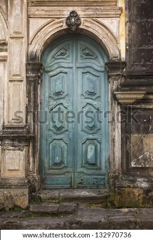 Old vintage green wooden church door. - stock photo