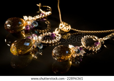 Old vintage jewelry set with semi-precious stones XXL, light painting - stock photo