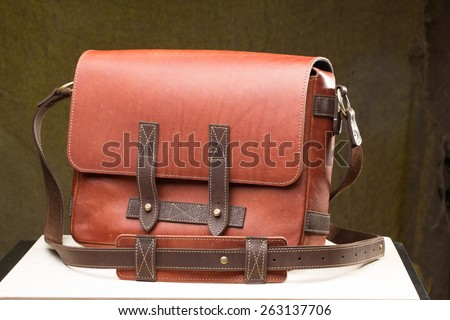Old vintage leather bag with leather strap  - stock photo