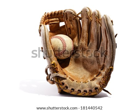 Old vintage leather baseball glove with the baseball held in the palm by the thumb standing upright on a white background - stock photo
