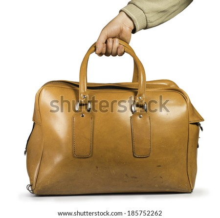 Old vintage luggage brown bag. White isolated - stock photo