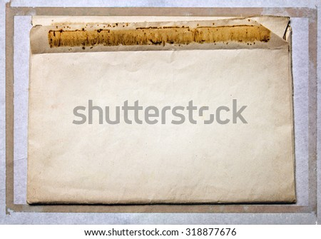 Old vintage mail envelope with retro border - stock photo