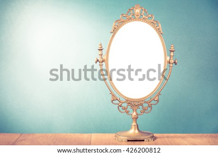 Old vintage makeup mirror frame for background. Retro style filtered photo - stock photo