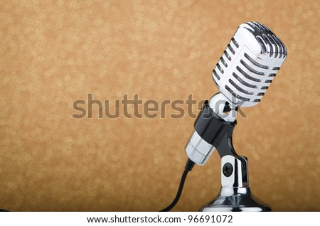 Old vintage microphone on background - stock photo