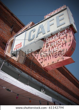 old vintage neon cafe sign on abandoned business - stock photo
