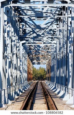 old, vintage one way frame railroad bridge - stock photo