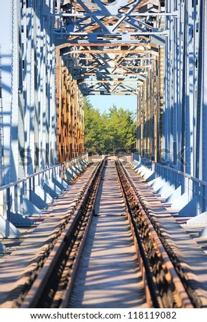 old, vintage one way frame railroad bridge - stock photo