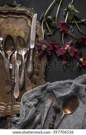 Old vintage ornamented cutlery and antique nickel copper tray  - stock photo