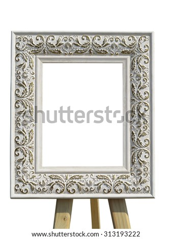 Old vintage ornate white picture frame with pattern on tripod isolated - stock photo