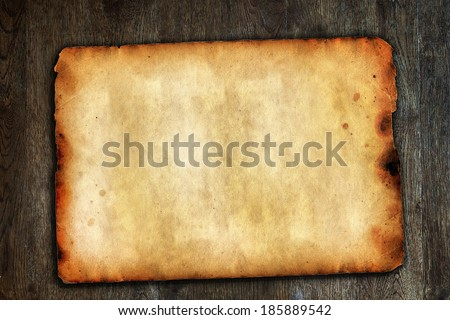 Old vintage paper on brown wooden surface with natural texture - stock photo
