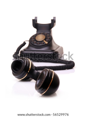 old vintage phone on white - stock photo