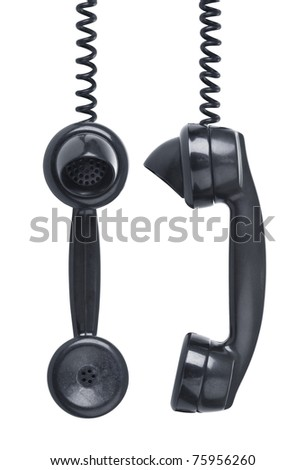 Old vintage phone with wear and tear hanging off the hook. Side and front view - stock photo