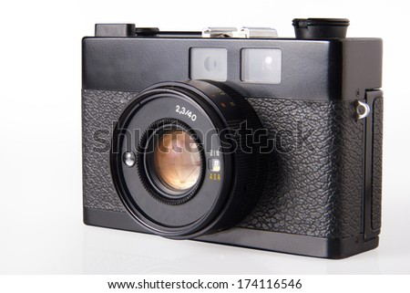 Old vintage photo camera, isolated on white - stock photo