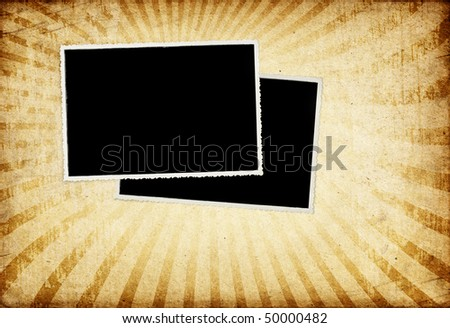 Old vintage photo-cards on grunge paper with sunburst background. - stock photo